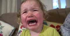 Toddler girl crying with mouth wide open and tears down her face Stock Footage