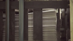Work of conveyor in printing plant, part of newspapers Stock Footage
