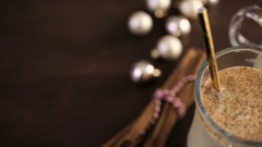 Traditional holiday drink egg nog garnished with nutmeg. Stock Footage