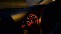 Dashboard and speedometer in a moving car at night Stock Footage