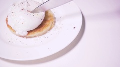 Slow mo poached egg on toast Stock Footage