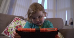 Little girl holding and using a tablet computer Stock Footage