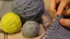 Knitting hands threads on spokes Stock Footage