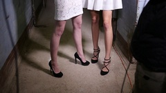 Thin slim young girls models legs during photo session backstage Stock Footage