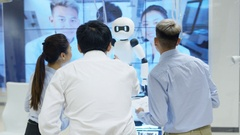 4K Electronics engineers testing design of robot with view of robot's image scan Stock Footage