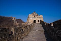 The great china wall with sunset glow Stock Photos