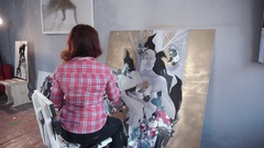 Female artist painting picture in studio Stock Footage