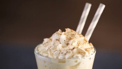 Traditional holiday drink egg nog garnished with whipped cream in the glass. Stock Footage
