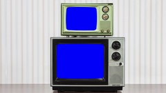 Two Vintage Televisions with Zoom into Chroma Key Blue Screen Stock Footage