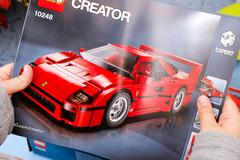 Child hands with Lego instruction of set 10248 Ferrari F40 Stock Photos