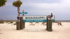 Welcome to Mississippi Gulf Coast Sign on Beach Stock Footage