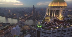 Bangkok Rooftop Bar and Restaurant With Chao Phraya in Background, Aerial Stock Footage