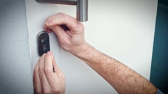 Burglar with lock picking tool opens the door to enter the house Stock Footage