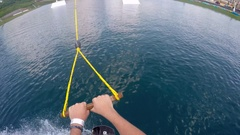 POV of a man riding his wakeboard at a cable park, slow motion. Stock Footage