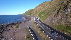 Aerial view of traffic on scenic coastal highway in Kapiti, New Zealand Stock Footage