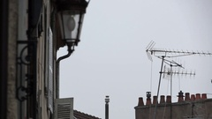 Roofs full of tv antennas and chimneys Stock Footage