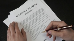 4K Signing a Divorce Agreement Document Stock Footage