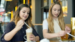 Girls spending time in the cafe and smiling to the camera, steadycam shot Stock Footage