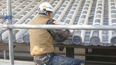 Workman repairing the Himeji Castle Stock Footage