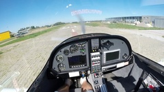 A flight on an airplane, in the cockpit. Take off from an airdrome. Stock Footage