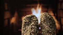 Feet in woollen socks by the fireplace Stock Footage
