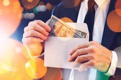 Bribery and corruption Stock Photos