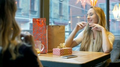 Girls talks with her best friend and wears Santa's hat, steadycam shot Stock Footage