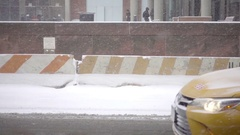 Taxi cab driving by in snow storm blizzard by NYU snowing in NYC Stock Footage