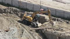 Excavator leveled the road to the construction site Stock Footage