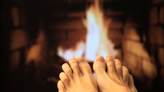Naked legs are heated by a fireplace Stock Footage