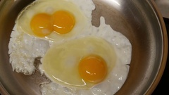 Double Yolk Egg Frying Pan Cooking Food Breakfast Sizzling Rare Natural Life 4k Stock Footage