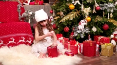 Little girl with gifts, Christmas surprise, A child plays in the house on Stock Footage