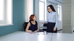 Two beautiful women discuss details conclusion of treaty at office Stock Footage