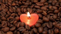 Lonely burning candle in the shape of heart. Closeup Stock Footage