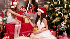 Girlfriends Santa's helper lays out the name cards on Christmas gifts, empty Stock Footage
