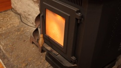 A dolly shot of pellet stove heating a room in winter Stock Footage