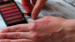 Woman holding a make up palette and brush, 4k close up. Stock Footage