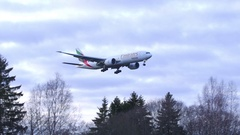 Emirates SkyCargo airplane fly by landing Stock Footage