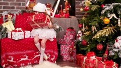 Gift wrapping, a little girl lays out name cards for Christmas gifts, Santa's Stock Footage