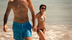 People relaxing on beach, enjoying sunny day, super slow motion 240fps Stock Footage