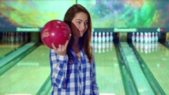 Girl holds bowling ball in her hands Stock Footage