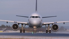Airplane taxiing front view low angle Stock Footage