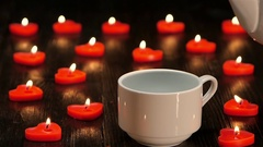 Nice little things in life - cup of coffee by candlelight Stock Footage