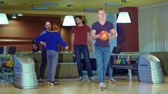 Friends high-fives man after his release at the bowling Stock Footage