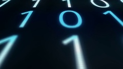 Camera pans across blurry defocused glitching computer binary code Stock Footage