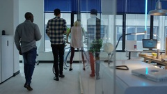 4K Casual business group arriving for work in morning in modern creative office Stock Footage