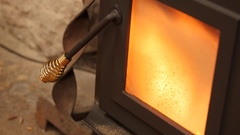 Dolly shot of pellet stove heating a room in winter Stock Footage