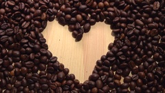 Background of falling coffee beans. Heart of the coffee beans. Stock Footage