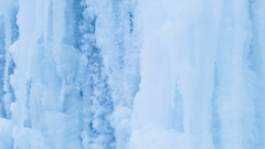 Blue Icy waterfall closeup. Cold icy water in winter. Arctic environment. Stock Footage