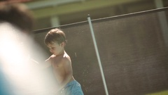 Child Exiting Pool with Frisby Stock Footage